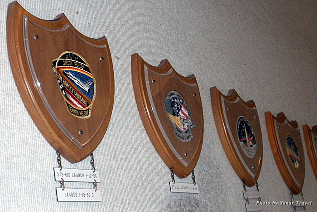 Plaques of missions that did not make it. The area where the return date tag should be is worn out from employees touching it