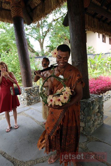 Coconut drink and flower welcome at Nanuku Resort and Spa