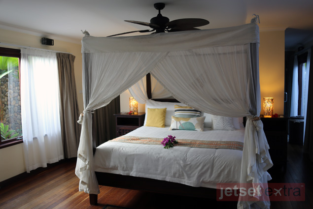 Beautiful bed and room inside one of Nanuku Resort and Spa's private villas