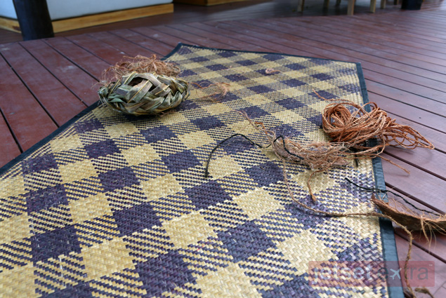 Some of the many uses of the coconut fruit and tree include making a floor mat, a basket, and rope