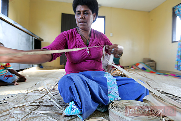 Manasa's sister making woven floor mats for the houses in their village