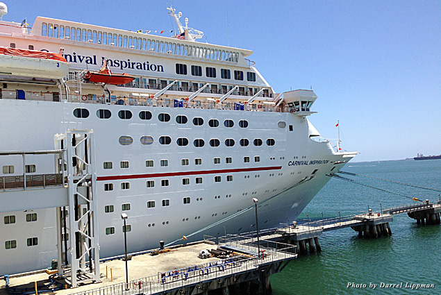 The Carnival Inspiration cruise ship docked in Long Beach