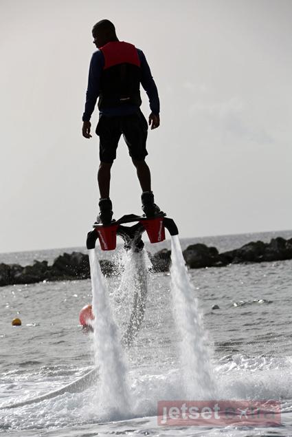 A resort employee demonstrates flyboarding