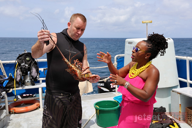 Executive chef Jason Adams shows JetSetSarah his lobster catch during the first portion of the Dive & Dine