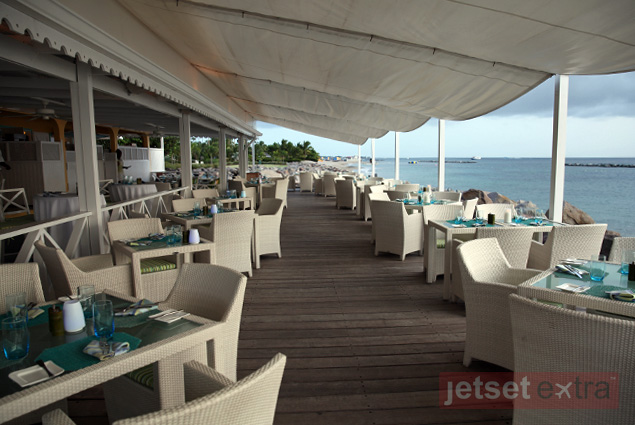 Outside seating on the water's edge at Mango