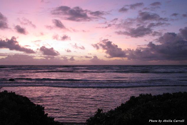 Kaua'i's purple sunrises inspired morning hula on the sand every morning