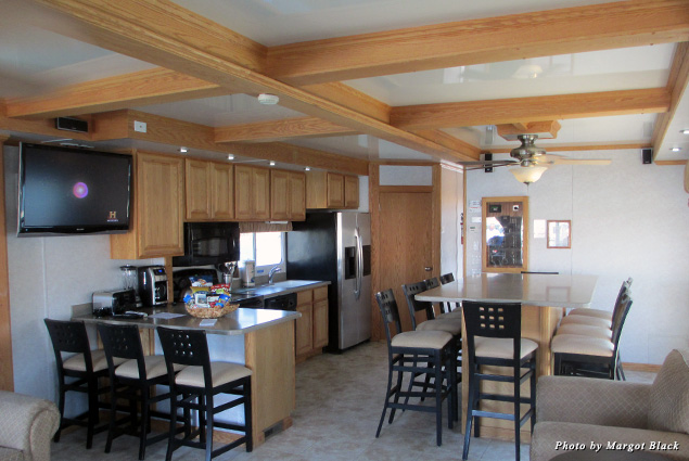 Looking into the houseboat's kitchen and dining area from the living room