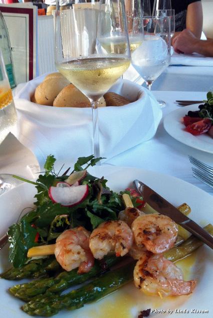 Tender baby shrimp on a bed of lightly dressed asparagus salad