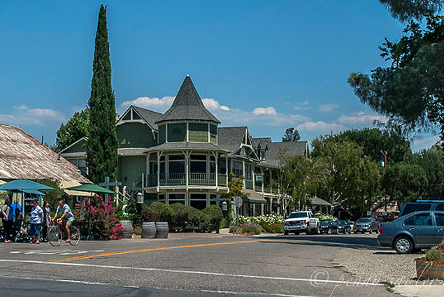 A Victorian home across the street in the historical village of Los Olivos