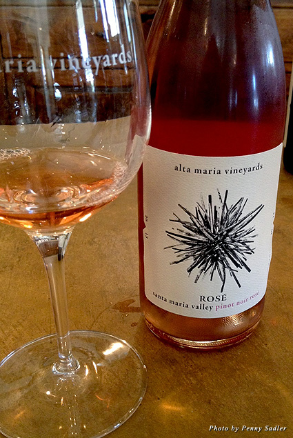 A bottle and glass of Alta Maria Rosé wine