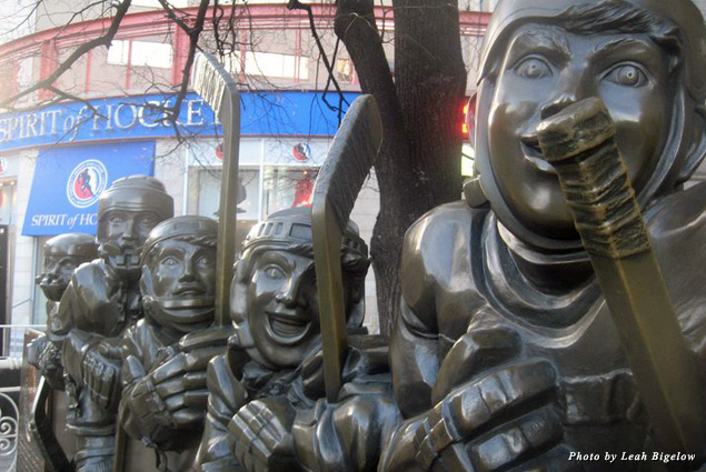 A statue of hockey players outside the Hockey Hall of Fame