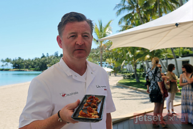 Chef Mangan offers tray-passed peperonata, goats curd, and basil crostini during a Virgin Australia luncheon at One&Only Hayman Island Resort