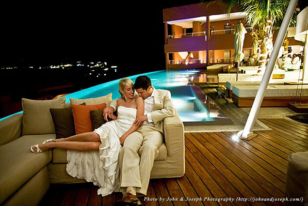 A couple shares private moment on an outdoor lounge