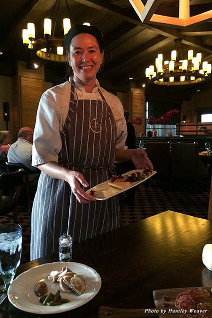 AVANT chef brings a charcuterie plate to the table