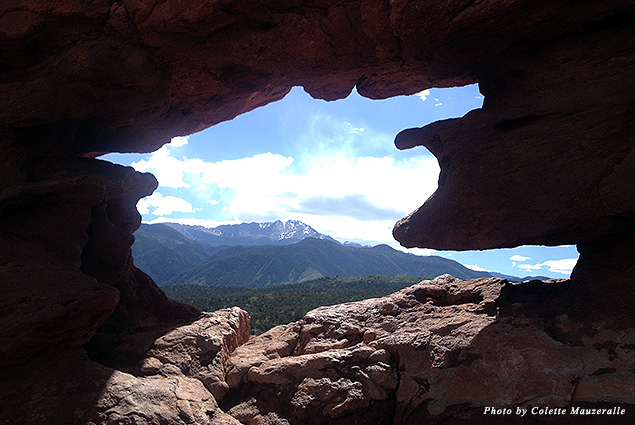 A view of Pikes Peak through a natural window at the top of the Siamese Twins Trail