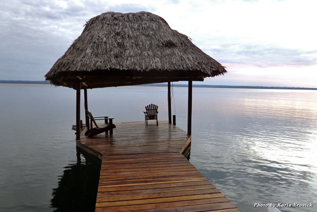 Admiring sunset over the water from a dock in Guatemala