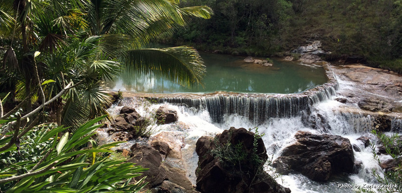 A small waterfall gushes over rocks in Belize