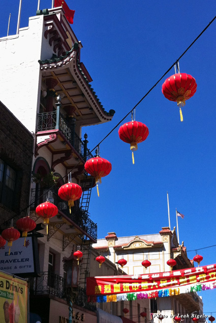 Paper lanterns hang between buildings in Chinatown