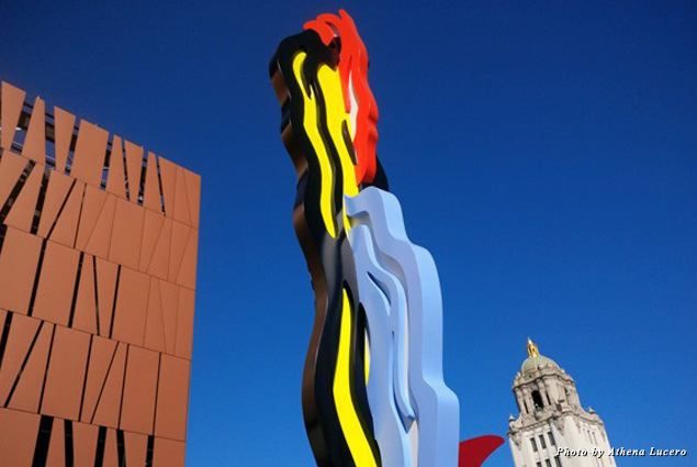 "Pop artist Roy Lichtenstein's 30-foot sculpture ""Coups de Pinceau"" (""Strokes"") bridges city icons—the new, ultra-modern Wallis Annenberg Center for the Performing Arts with City Hall's 1932 Spanish Renaissance tower"