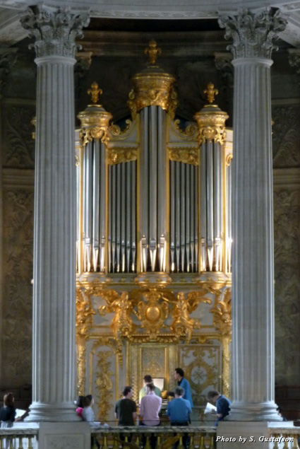 The magnificent pipe organ in the two-story chapel is framed by massive columns that are more evidence of the palatial scale of the main château
