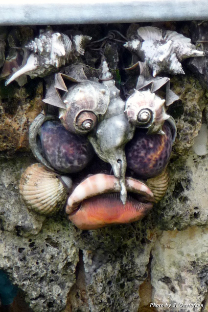 The shell faces embedded into the water fountains look like South Pacific islanders