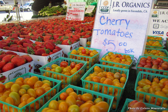 Locally grown produce, like these cherry tomatoes and strawberries, is abundant at the Little Italy Mercato