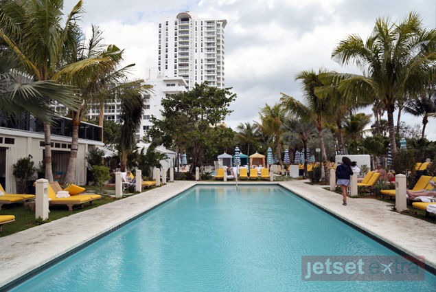 Yellow lounge chairs line the Thompson Miami Beach's two pools