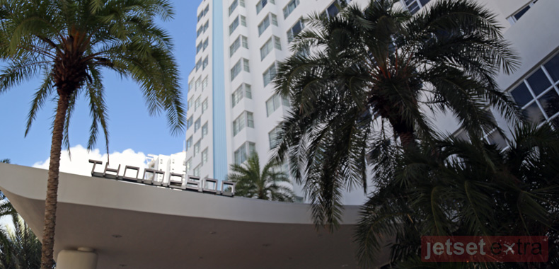 Palm trees line the Thompson Miami Beach signage and central tower