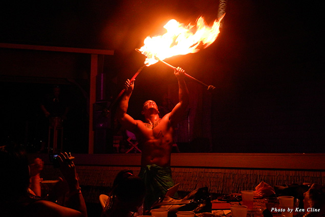 Fire dancers are one of the most dramatic performers at a luau