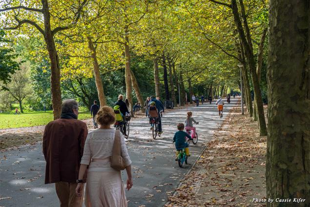 People walk through popular public park Vondelpark