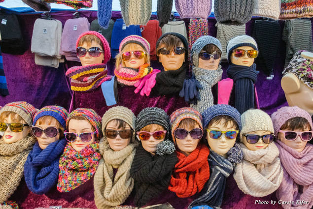 Mannequins model hats, scarves, and sunglasses at Amsterdam's Albert Cuypmarkt