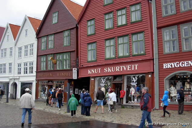 The Hanseatic League merchant buildings along old Bryggen wharf greet visitors with boutiques, artists' galleries, cafés, and museums