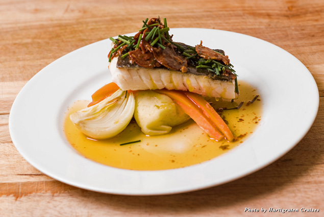 """Hurtigruten's """"Coastal Kitchen"""" features seasonal ingredients bought and caught along the way, like this fresh cod with herbs, Norwegian chorizo, and confit of local onions"""