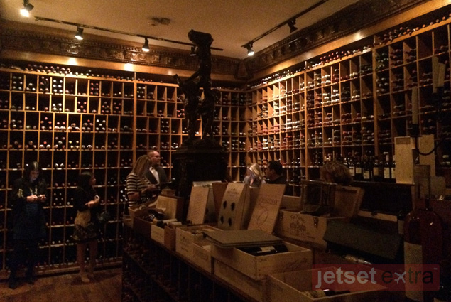 Walls lined with bottles in one of the wine rooms at the Forge
