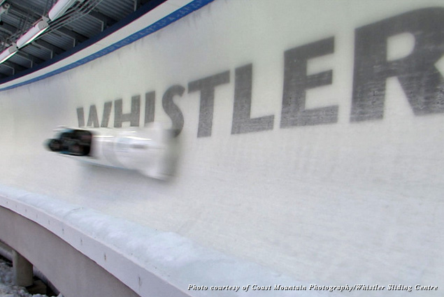 A blurry bobsleigh zips down the track at Whistler Sliding Centre