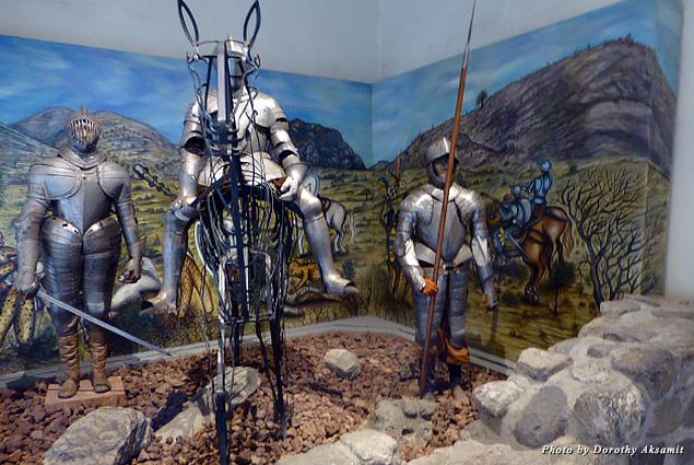 Exhibit of soldiers in metal armor mounted on horseback