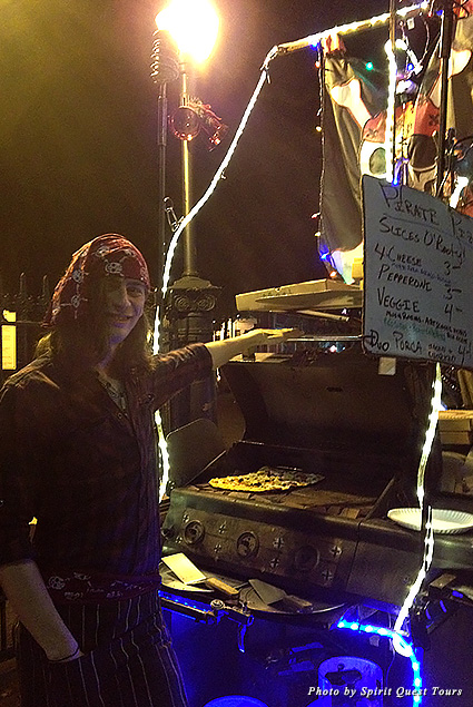 Matt, co-owner of Pirate Pizza, grills pies at his mobile pop-up