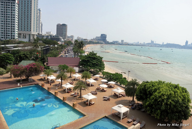 View of the pool and beach beyond from the Dusit Thani Hotel