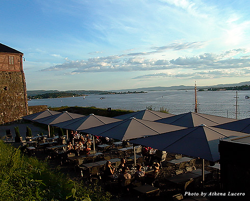 At Festningen Restaurant in Oslo guests dine al fresco along the walls of Akershus Fortress
