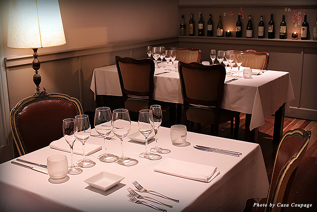 Dining room and display of wines at Casa Coupage