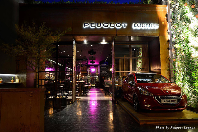 Entrance to Peugeot Lounge showcasing a Peugeot automobile