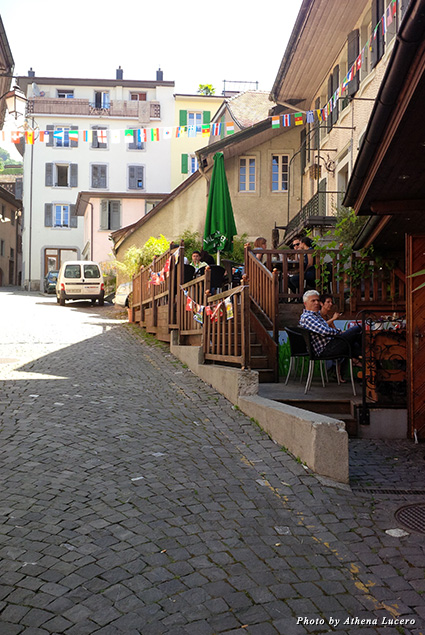 Café-goers enjoying the peaceful respite of Montreux's Vielle Ville, its Old Town