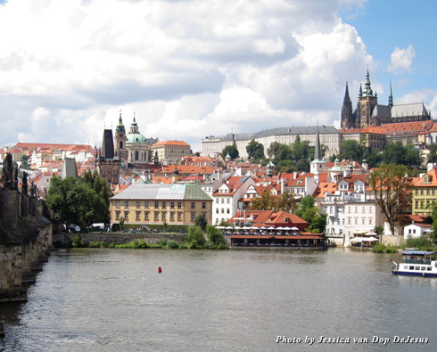 Looking across the Vltava River to buildings on the hills of Prague