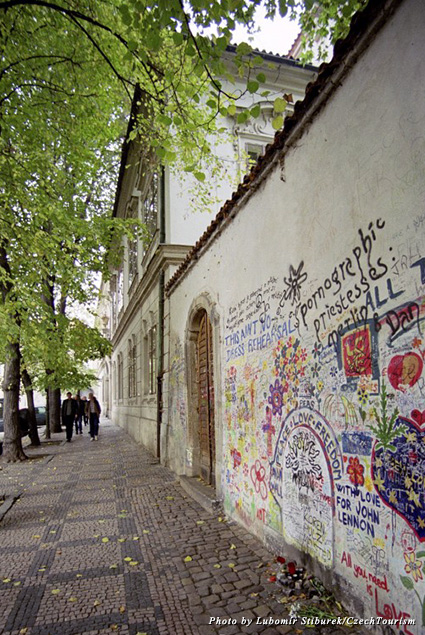 Graffitied messages of peace and love cover the Lennon Wall in Prague