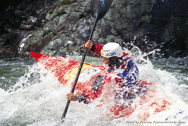 A person white water rafting in a kayak
