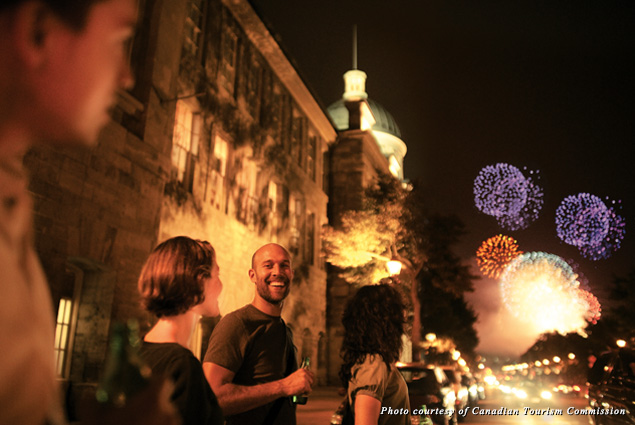 People watch fireworks during Montréal's L'International des Feux Loto-Quebec