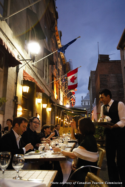People dine on a restaurant terrace in Old Montréal