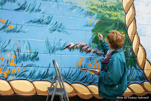 A volunteer artist restores one of the city's prized murals