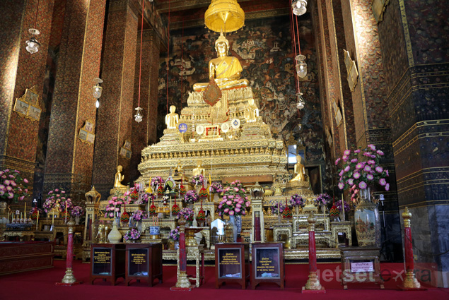 Inside Phra Ubosot, looking at up at the gold statue of Phra Buddha Theva Patimakorn