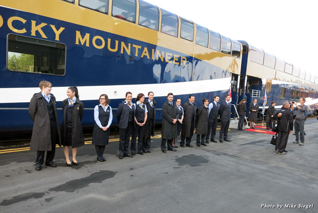 Rocky Mountaineer employees welcome passengers as they board the train in Vancouver